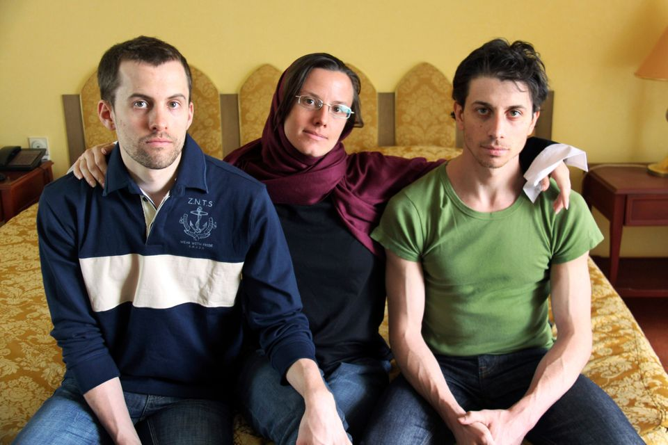 In this May 20, 2010, file photo, American hikers Shane Bauer, left, Sarah Shourd, center, and Josh Fattal, sit at the Estegh