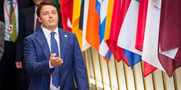 Italian Premier Matteo Renzi gestures as he leaves the EU Council building at the end of an EU summit...