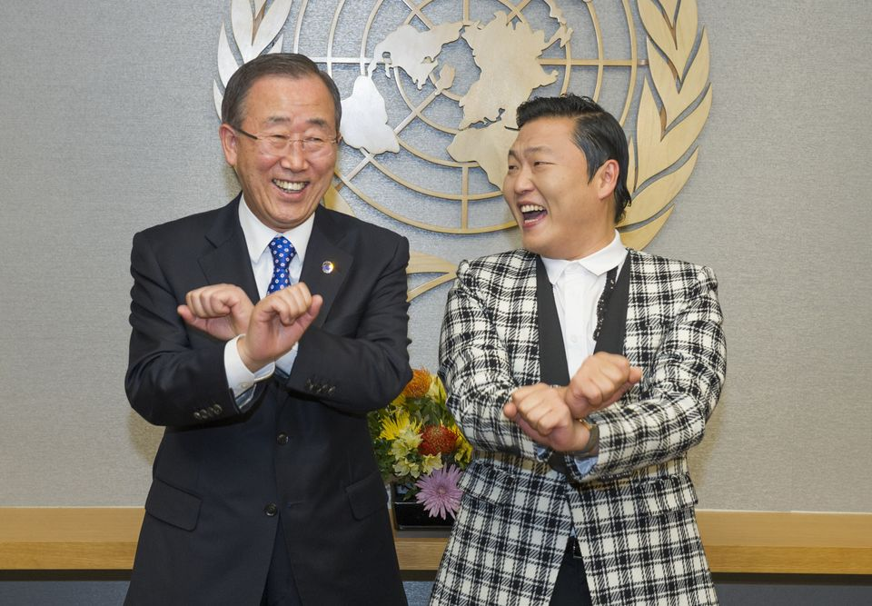 In this Oct. 23, 2012 photo provided by the United Nations, UN Secretary-General Ban Ki-moon, left, is taught how to dance Ga