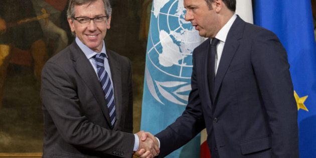 Italian Premier Matteo Renzi, right, shakes hands with United Nations special envoy for Libya Bernardino...