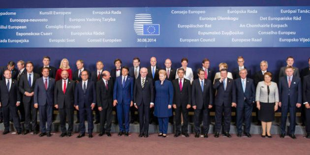 European Union leaders pose during a group photo at an EU summit in Brussels, Saturday, Aug. 30, 2014....