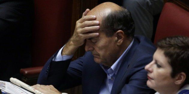 Democratic Party's Pierluigi Bersani touches his forehead ahead of a confidence vote at the Lower Chamber,...