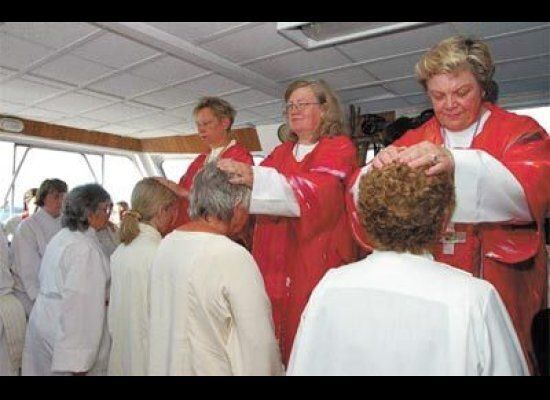 Roman Catholic Female bishops—yes, they now exist—ordaining womenpriests on a boat sailing acros St. Lawrence Seaway in Canad