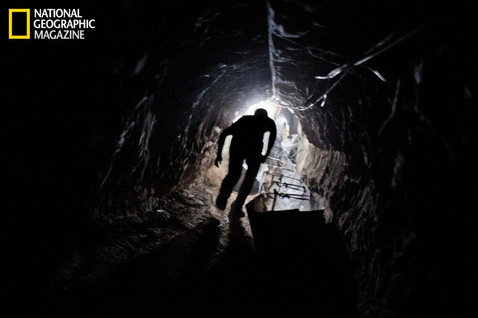 A worker emerges from one of hundreds of smuggling tunnels that connect the Gaza Strip and Egypt. (Paolo Pellegrin/National G