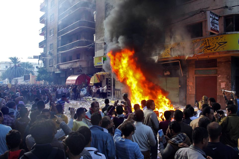 Protesters storm an office of Egyptian President Mohammed Morsi's Muslim Brotherhood Freedom and Justice party and set fires