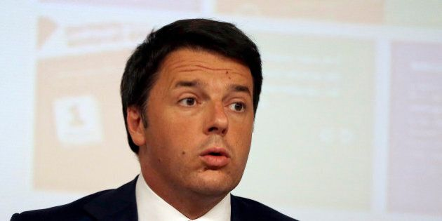 Italian Premier Matteo Renzi arrives at a press conference to announce the government's agenda for the...