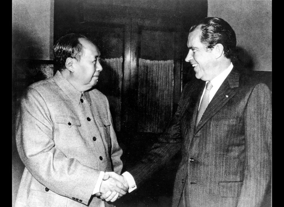 U.S. President Richard Nixon, a staunch anti-Communist through much of his political career, shakes hands with Chinese Commun