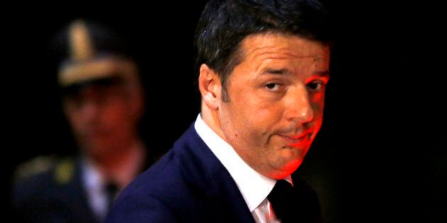 Italian Premier Matteo Renzi leaves the Italian Embassy to the Holy See at the end of a ceremony celebrating...