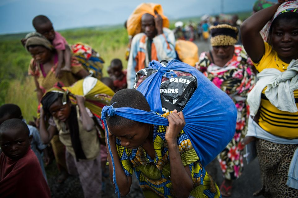 Thousands of Congolese flee the town of Sake, 26km west of Goma, following fresh fighting in the eastern Democratic Republic