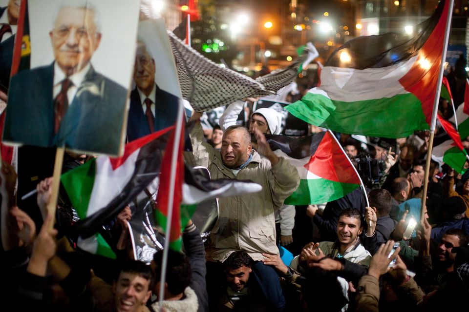 RAMALLAH, WEST BANK - NOVEMBER 29: Palestinians celebrate in the streets on November 29, 2012 in Ramallah, the West Bank. The