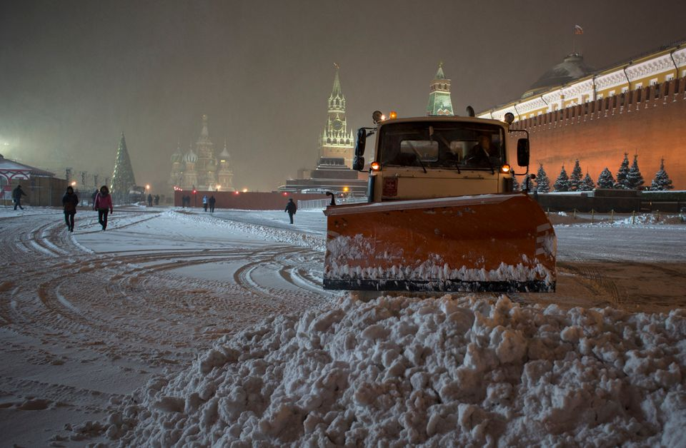 A bulldozer removes snow in Red Square in Moscow, Russia, early Thursday, Nov. 29, 2012. A snowfall hit Moscow on Wednesday w