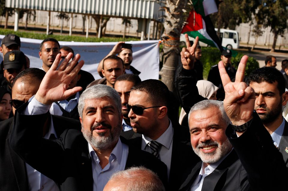 Exiled Hamas chief Khaled Mashaal, left, and Gaza's Hamas Prime Minister Ismail Haniyeh upon Meshaal's arrival at Rafah cross