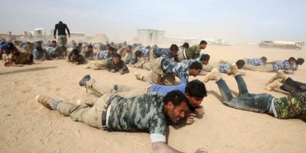 Members of the popular mobilisation unit attend a combat training session at a military camp in the Iraqi...