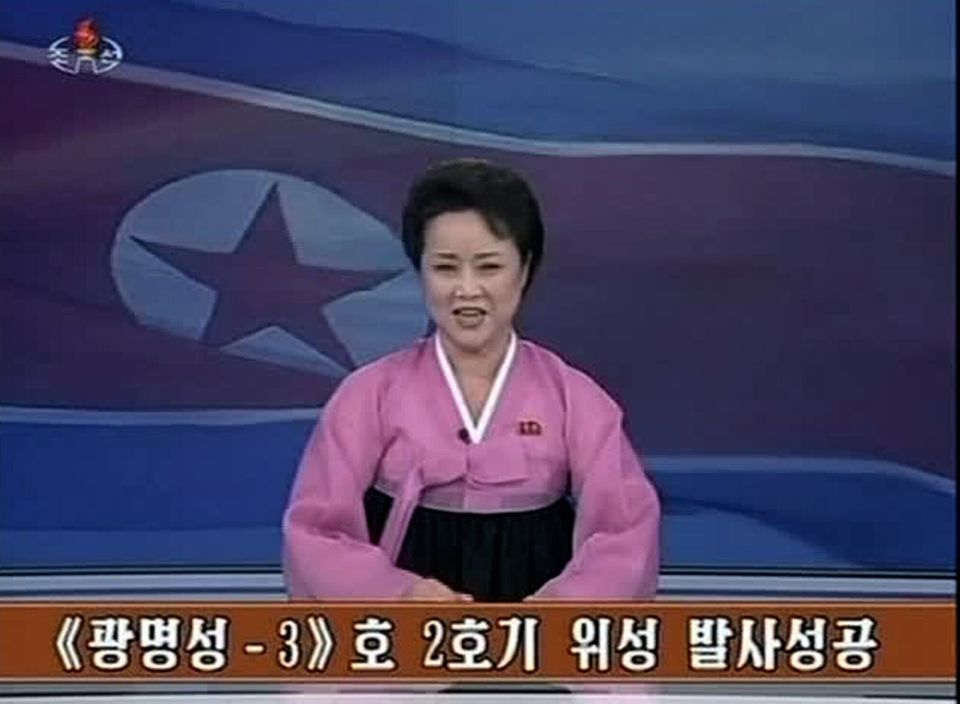 This image taken from KRT video shows an anchorwoman announcing the country's successful rocket launch in a TV program in Pyo