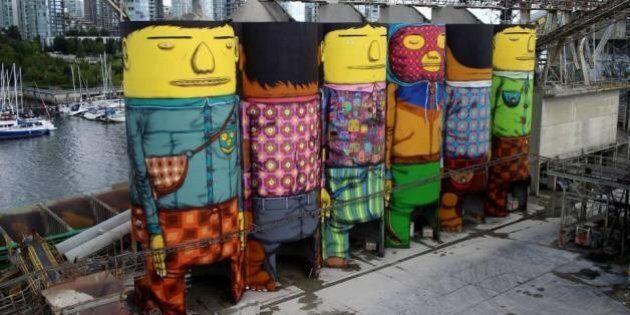 OSGEMEOS. La street art dei gemelli brasiliani conquista Vancouver. Silos trasformati a colpi di graffiti