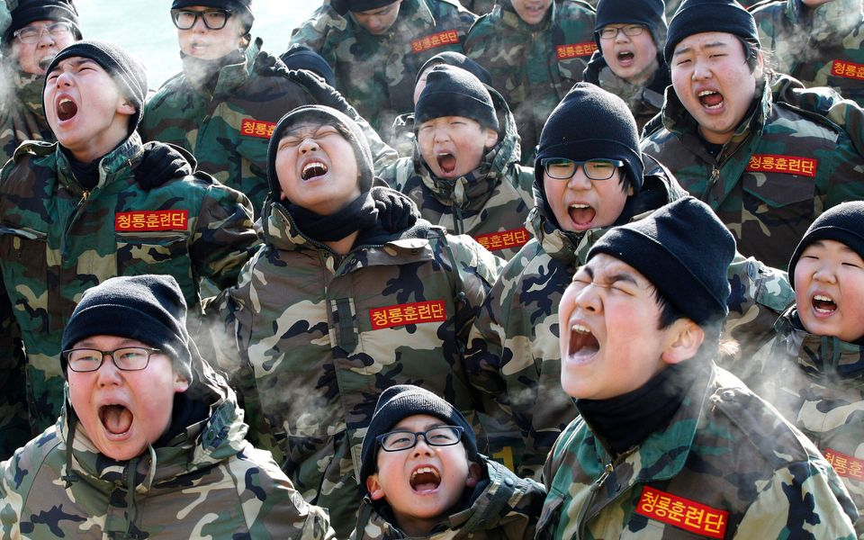 South Korean elementary and middle school students shout slogans during a winter military camp for chidlren at Cheongryong Se