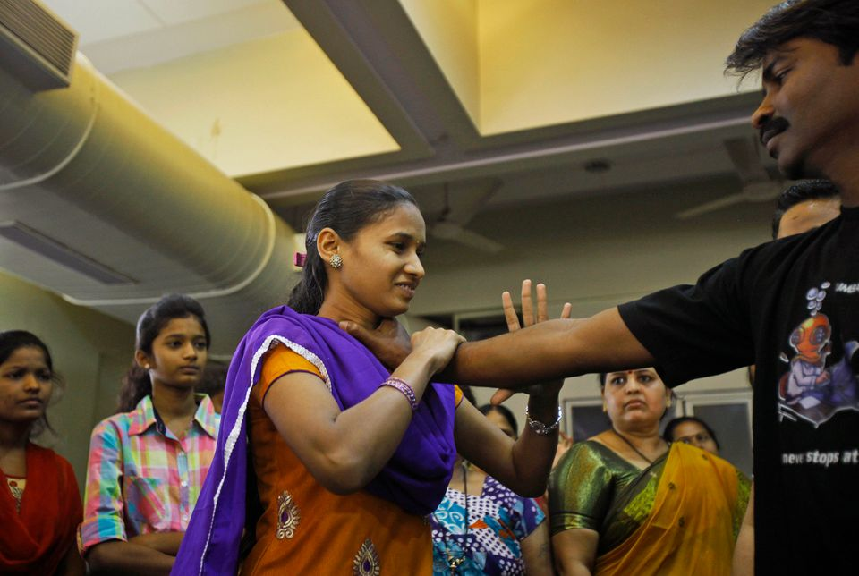 A female school staff member participates in a self defense training program at a school in Mumbai, India, Friday, Jan. 4, 20