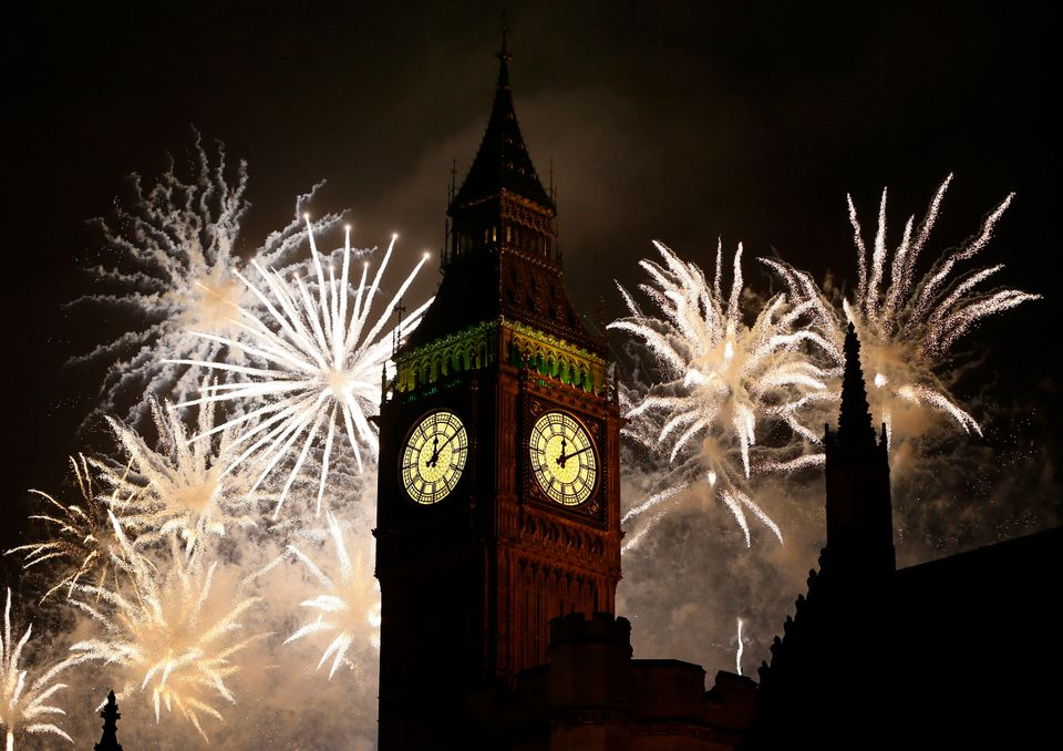 Fireworks explode over Elizabeth Tower housing the Big Ben clock to celebrate the New Year in London, Tuesday, Jan. 1, 2013.