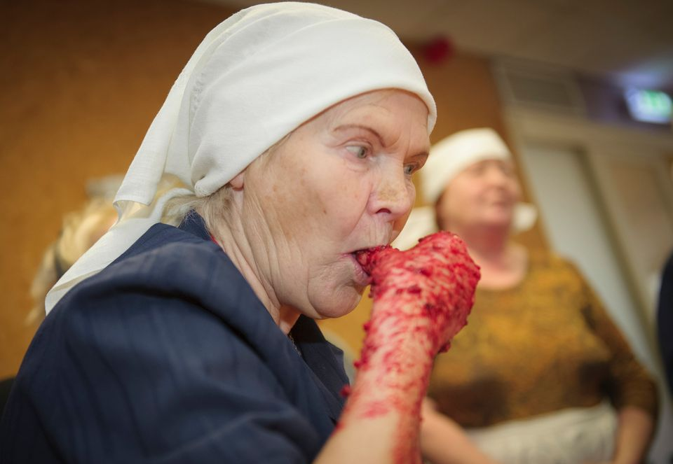 72-year old Estonian Siina Taal prepares Estonian blood sausage in Tallinn, Estonia, on December 15, 2012. (RAIGO PAJULA/AFP/