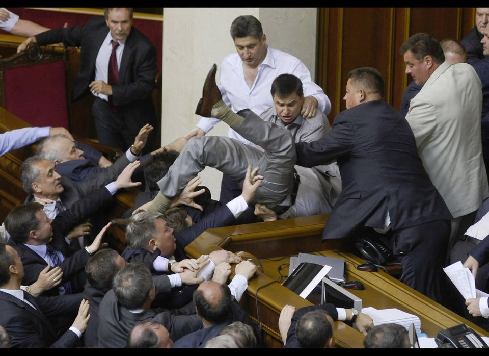 Lawmakers from pro-presidential and oppositional factions in the parliament session hall in Kiev, Ukraine, Thursday, May 24,