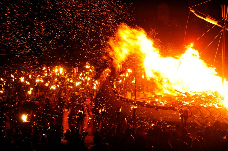 Members of the 2013 'Jarl Squad' take part in the annual Up Helly Aa festival which culminates in the burning of a Viking Gal