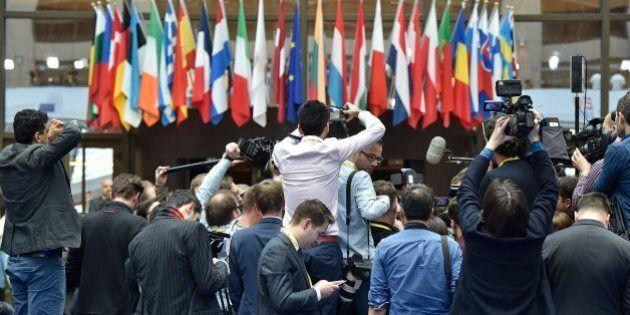 Members of the media surround Poland's European Affairs Minister Konrad Szymanski during an EU summit...