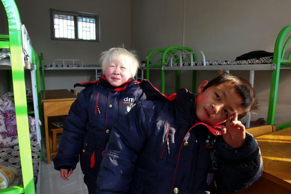 In this Saturday, Jan. 5, 2013 photo, two children who survived from a fire at an unregistered orphanage play at an orphanage