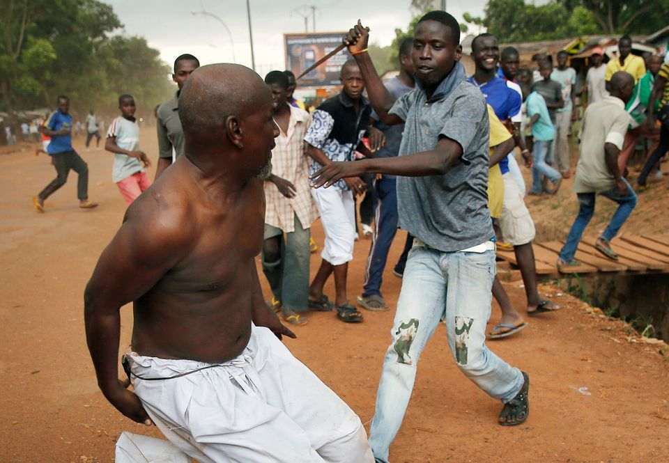 A Christian man chases a suspected Seleka officer in civilian clothes with a knife near the airport in  Bangui, Central Afric
