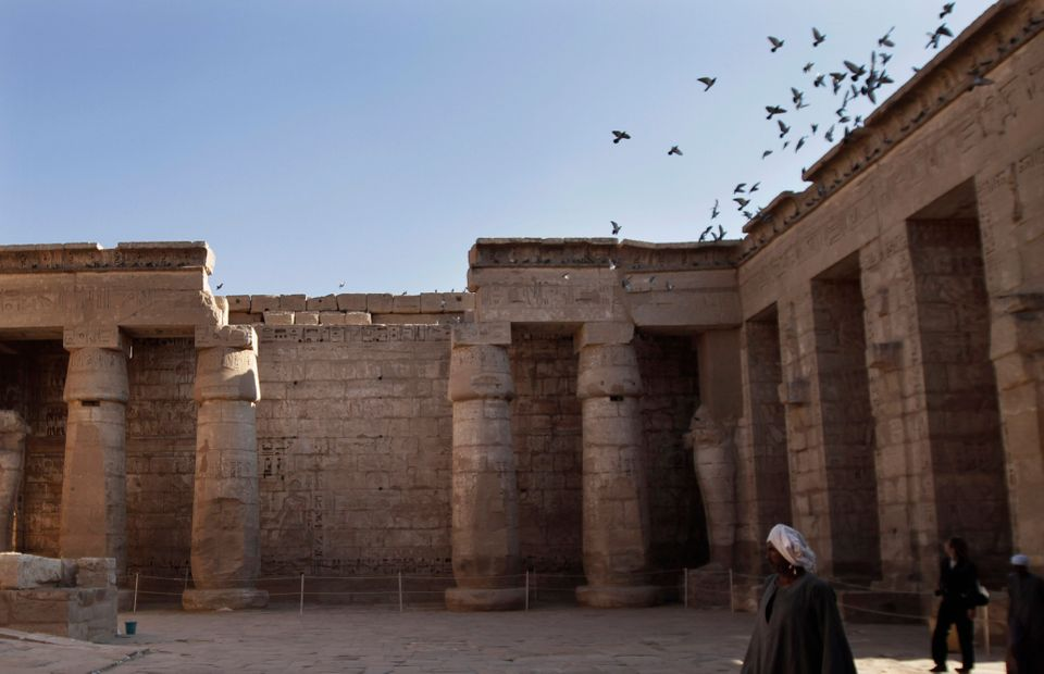 A tourist visits Ramses III's Temple in Luxor, Egypt, Friday, Nov. 23, 2012. (AP Photo/Nariman El-Mofty)