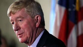Former Massachusetts Gov. William Weld addresses a gathering during a New England Council 'Politics & Eggs' breakfast in Bedford, N.H., Friday, Feb. 15, 2019. Weld announced he's creating a presidential exploratory committee for a run in the 2020 election. (AP Photo/Charles Krupa)