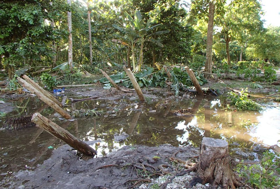 In a photo provided by Work Vision, a village is destroyed in the area of Lata, Temotu province, Solomon Islands after a powe