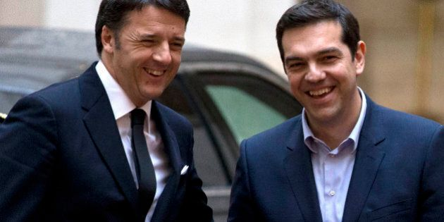 Italian Premier Matteo Renzi, left, welcomes Greek Prime Minister Alexis Tsipras, as he arrives for a...