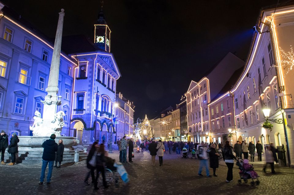A crowd walks in the centre of Ljubljana during year-end festivities and celebrations for the upcoming new year on December 2