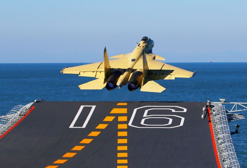 In this undated photo released by China's Xinhua News Agency, made available on Sunday, Nov. 25, 2012, a carrier-borne J-15 f