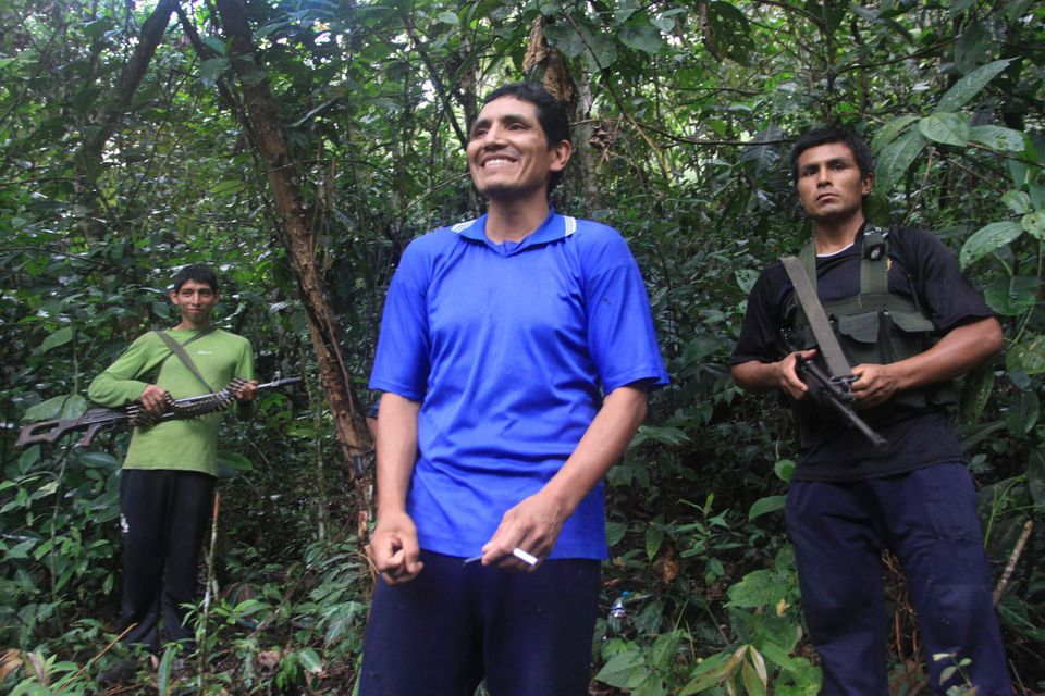 "In this photo taken Tuesday, April 17, 2012, Martin Quispe Palomino, also known as ""Comrade Gabriel,"" center, a member of the"