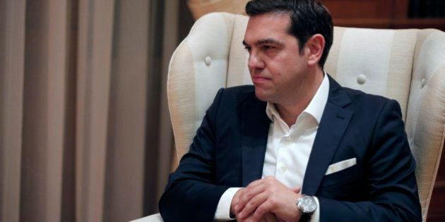 The newly re-elected Prime Minister Alexis Tsipras listens to Greece's caretaker Prime Minister Vassiliki...