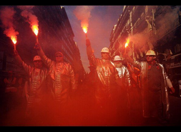 Metallurgists workers demonstrate with flairs in Marseille.