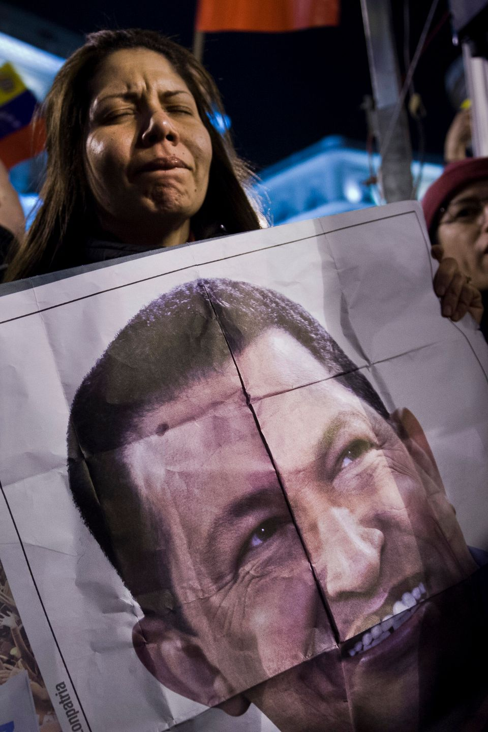 A supporter of late Venezuelan President Hugo Chavez cries during a homage gathering in Madrid, Wednesday, March 6, 2013. Som