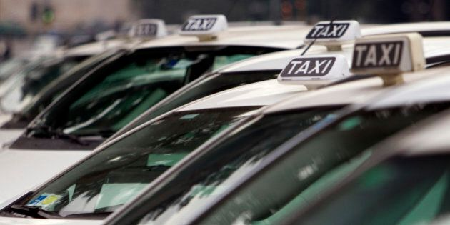 Taxi are aligned up next to Rome's Circus Maximus ancient arena during a drivers' strike against the...