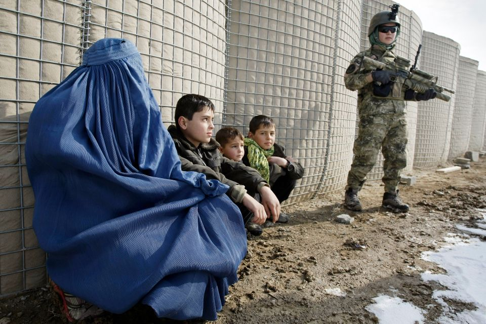 In this Monday, Jan. 14, 2013 photo a female member of Afghan special forces, right, stands guard during a training exercise