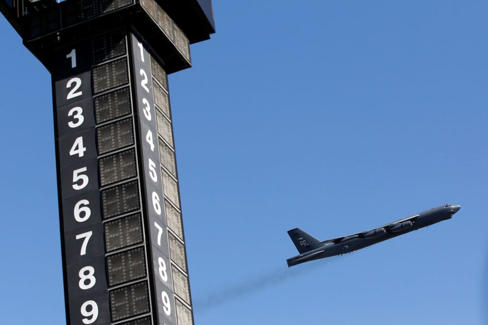 A B-52 bomber preforms a fly over during the national anthem prior to the start of the NASCAR Sprint Cup Series AAA Texas 500