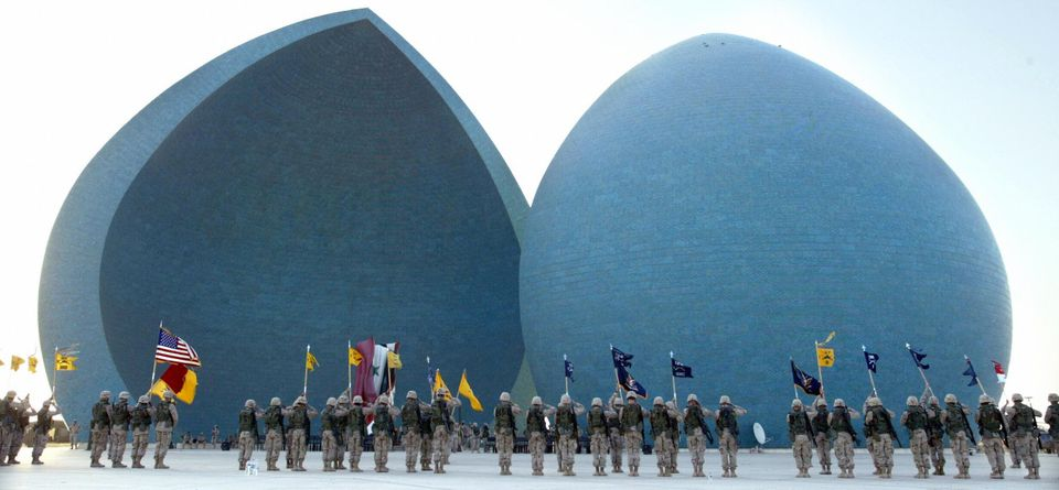 US soldiers of the 1st Brigade Combat Team, 1st Armoured Division, stand to attention at the Iraqi Martyr's Monument, in Bagh