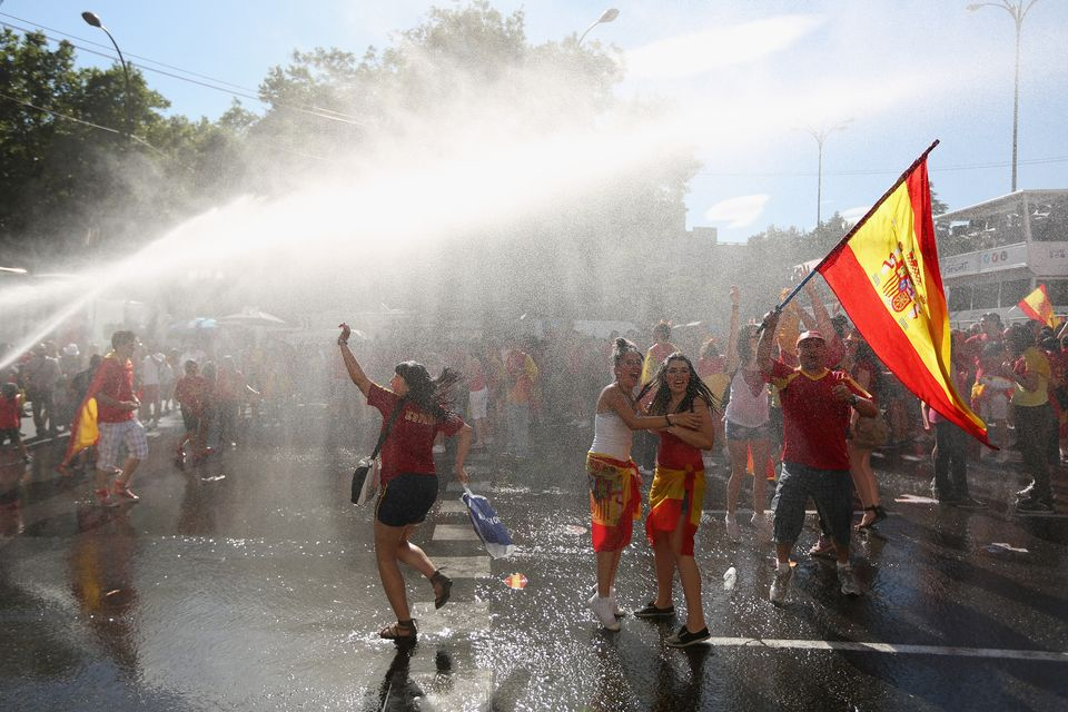 2012 Democracy Score: 8.02 2011 Democracy Score: 8.02  <em>Supporters of Spain's national football team are hosed down by a f