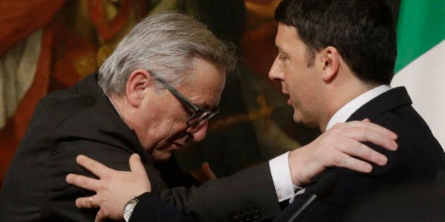 Italian Premier Matteo Renzi, right, and EU Commission President Jean-Claude Juncker attend a press conference...