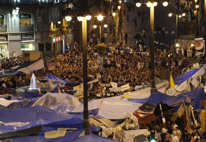 Protesters camp at the Puerta del Sol square in Madrid on May 26, 2011 during a demonstration against Spain's economic crisis