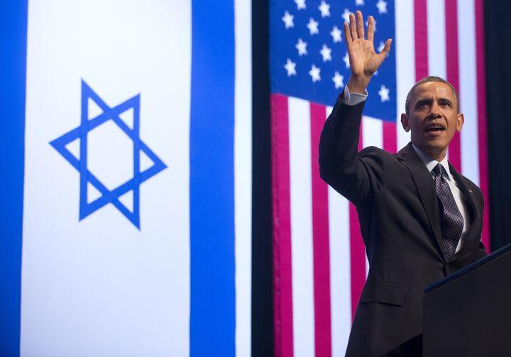 US President Barack Obama waves as he arrives to speak on US, Israel and Mideast relations at the Jerusalem Convention Center