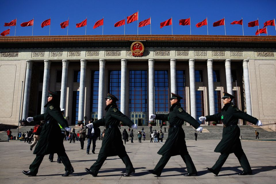 Chinese military soldiers match past the front of the Great Hall of the People after a pre-opening session of the National Pe