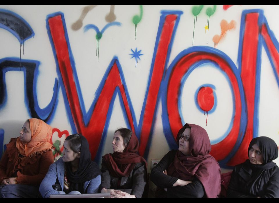 Afghan women gather during the opening ceremony of the Sahar Gul net cafe, the first internet cafe for women, opened in Kabul