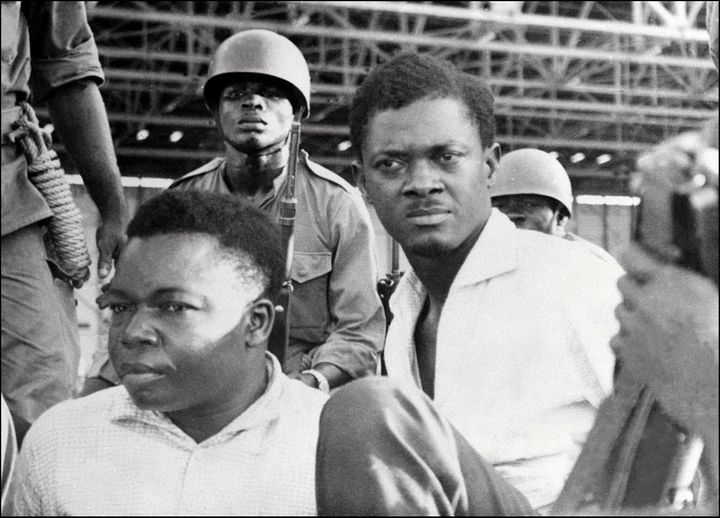 Soldiers guard Patrice Lumumba (R), Prime Minister of then Congo-Kinshasa, and Joseph Okito (L), vice-president of the Senate