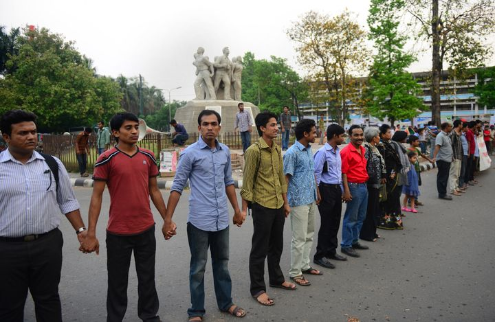 Bangladeshi bloggers form a human chain to protest against the detention of three bloggers at Dhaka University campus in Dhak